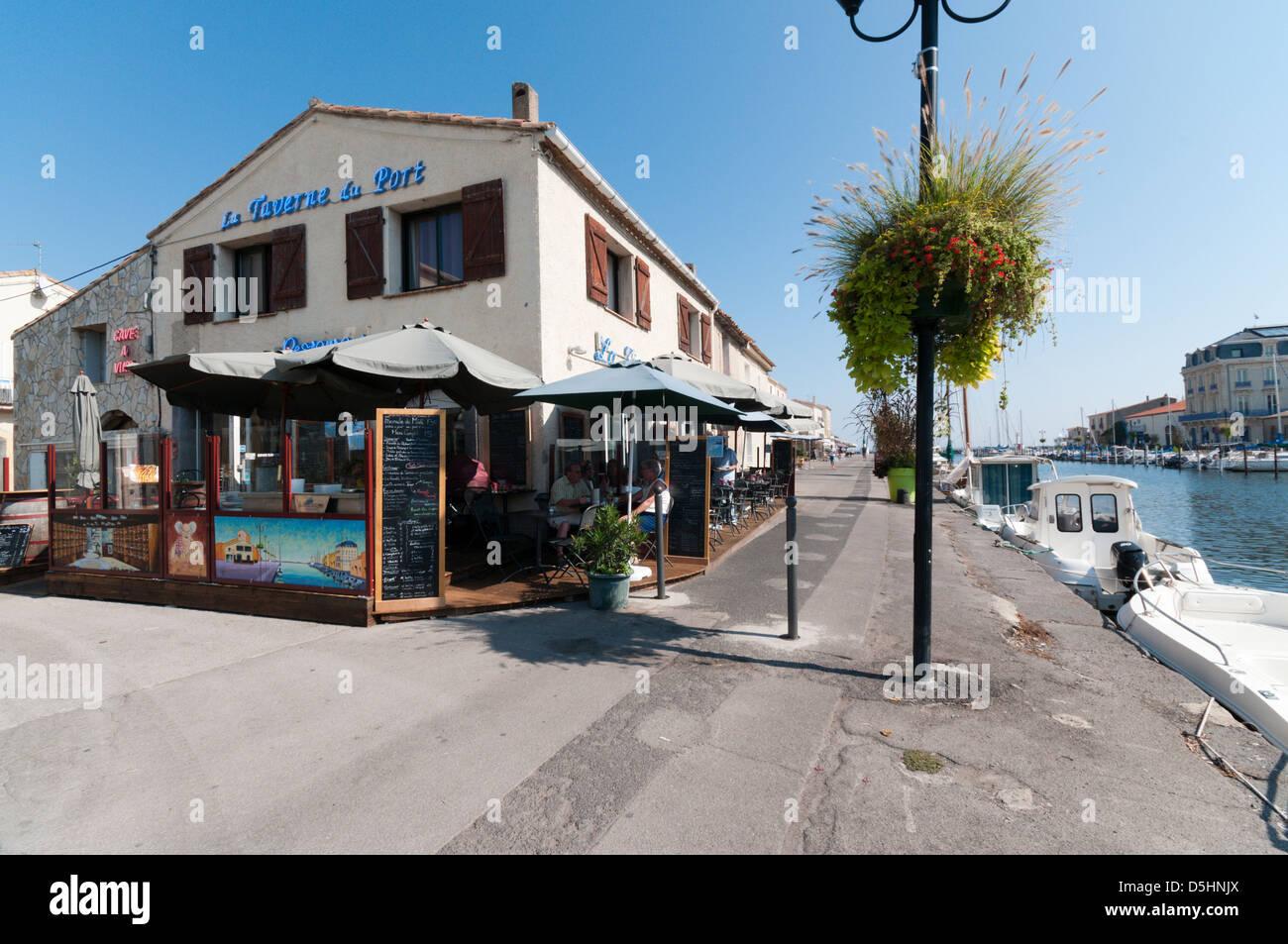 La Taverne du Port restaurant on the harbour front at Marseillan, Languedoc, France Stock Photo