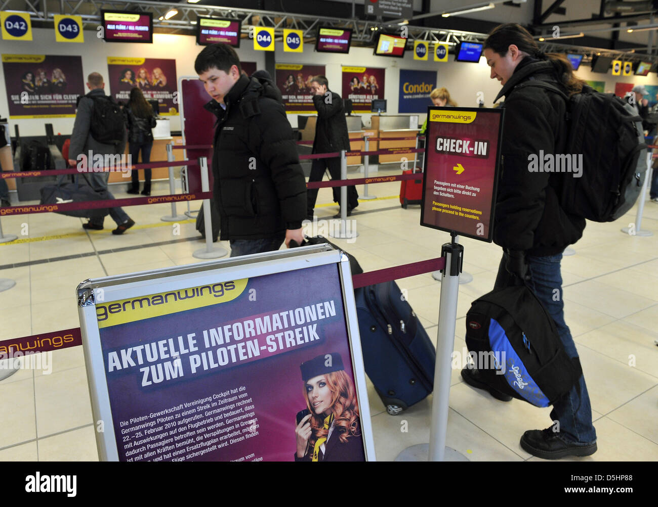 Air Passengers Stand At A Check In Counter Of Germanwings At Stock