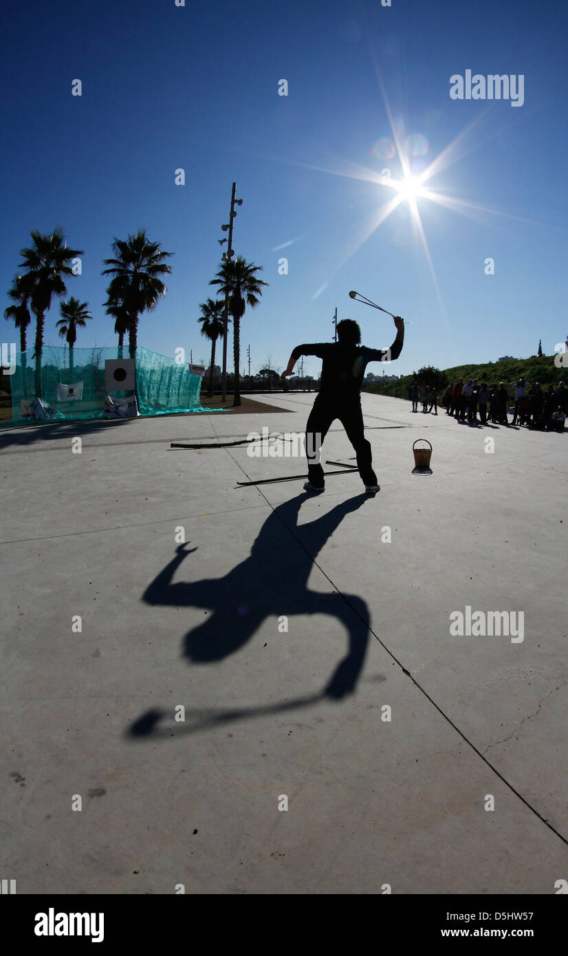 A slinger throws a stone during a sling demonstration in the Spanish island of Mallorca - Stock Image