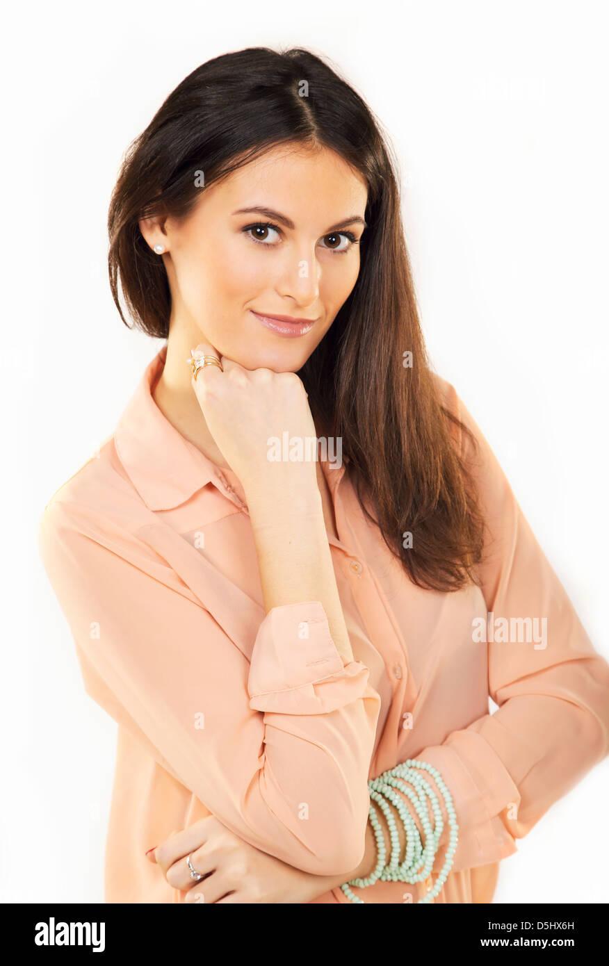 Portrait of a beautiful brunette inside a studio - Stock Image