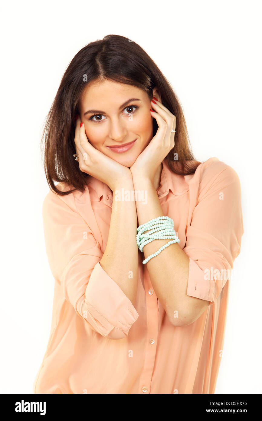 Charming and joyful woman with pearl bracelet posing in a studio - Stock Image