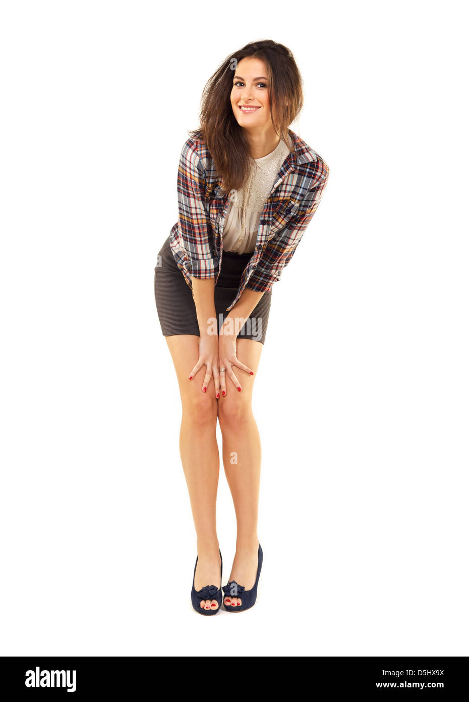Portrait of an attractive female having fun in a studio - Stock Image