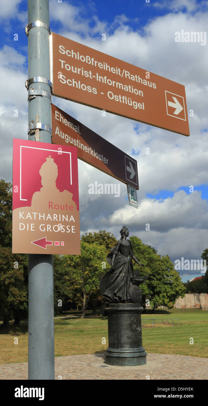 "A sign of the ""Catherine the Great"" route stands near a monument to the tsar in Zerbst, Germany, 19 September 2012. Stock Photo"
