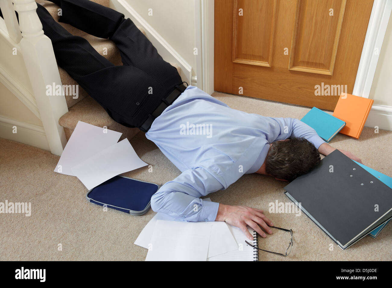Falling down the stairs - Stock Image