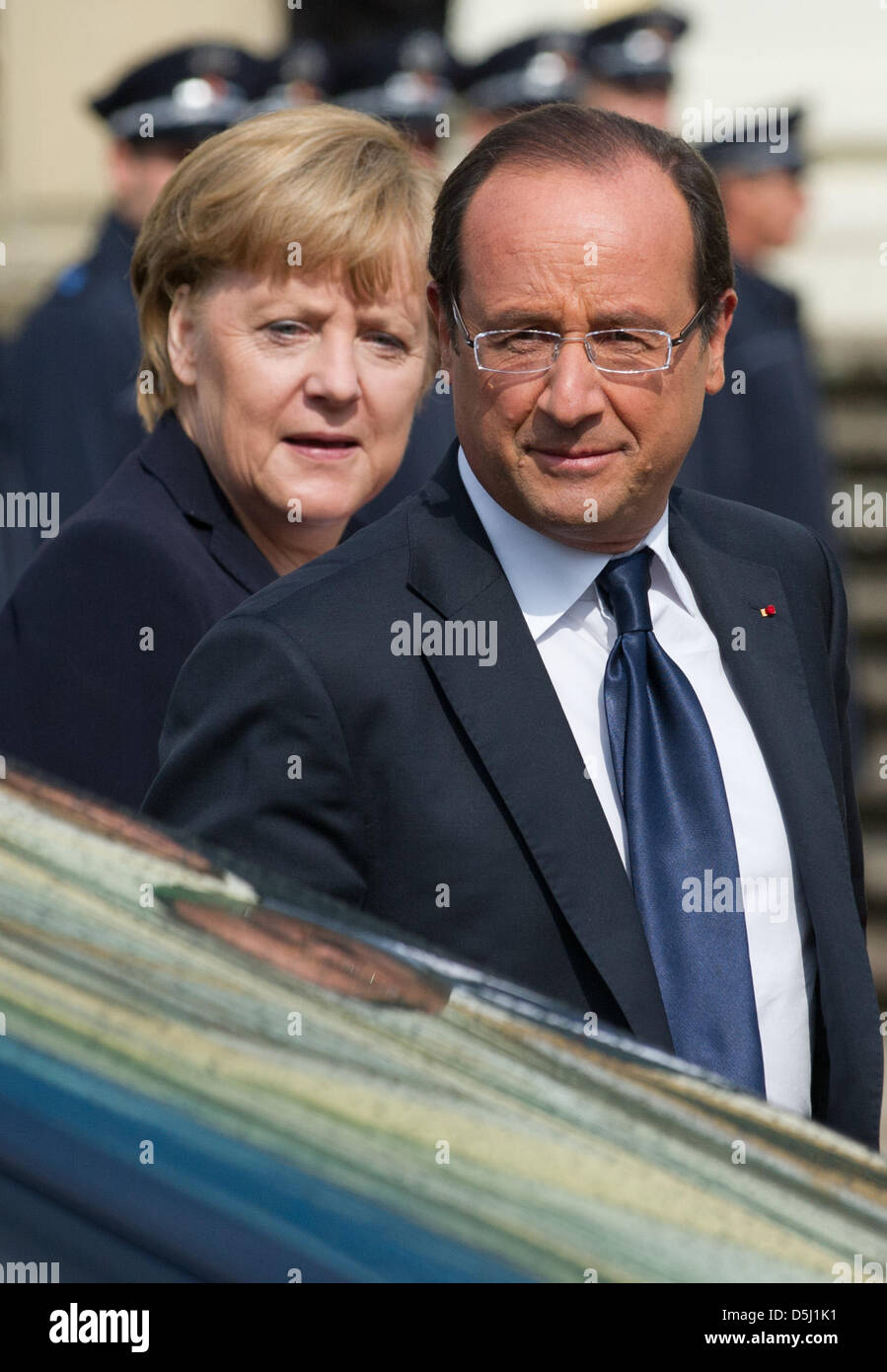 German Chancellor Angela Merkel and former French president Nicholas Sarkozy recommend
