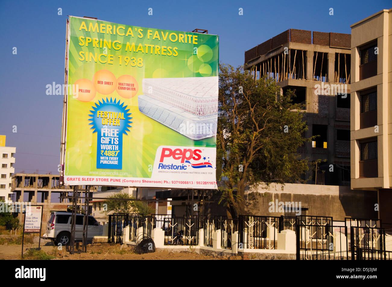 Advertising hoarding in Pune Maharashtra India for Peps Restonic mattresses - Stock Image