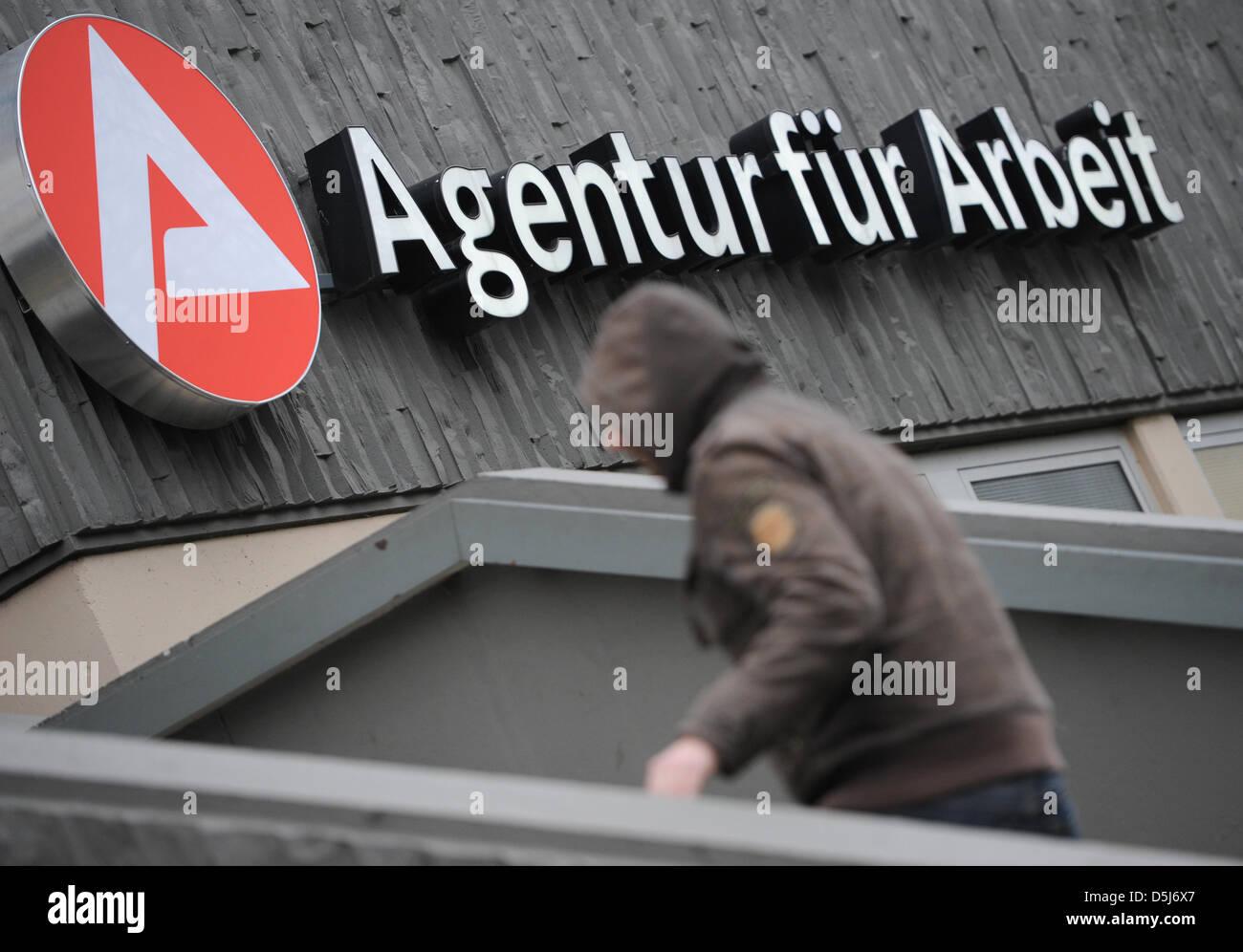 A man walks towards the Agentur fuer Arbeit (German employment agency) in Wiesbaden,Germany, 15 November 2012. Stock Photo