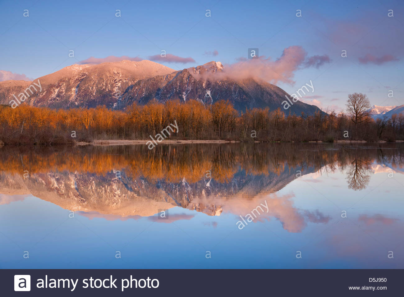 A snow storm clears at the summit of Mount Si, a 4,167 foot (1,270 meter) mountain near North Bend, Washington. - Stock Image