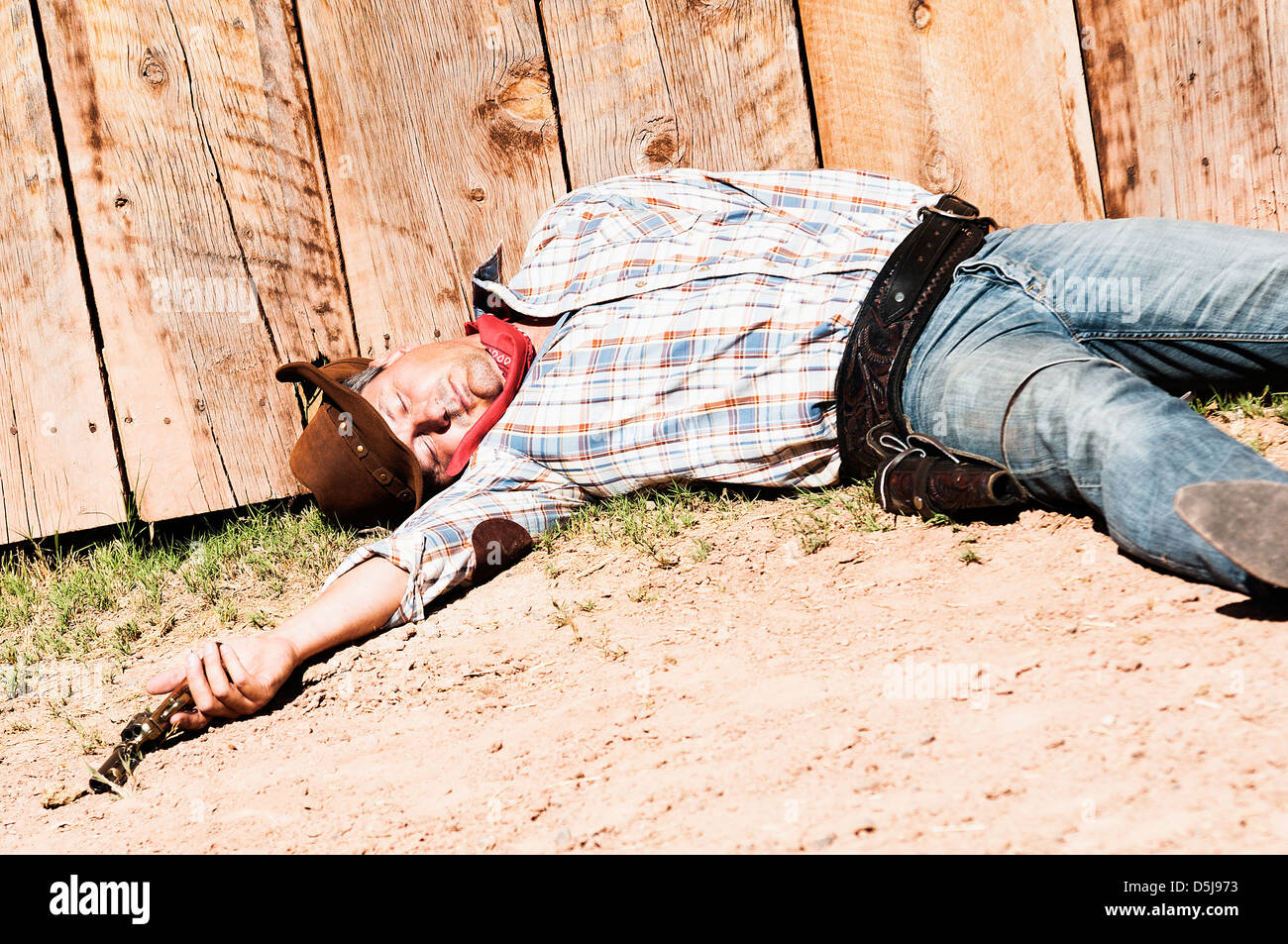 SOUT WEST - A cowboy dead with arm in his hand - Stock Image