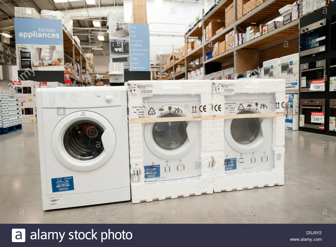 Kitchen appliances for sale inside a B&Q store. New washing machines for sale. - Stock Image