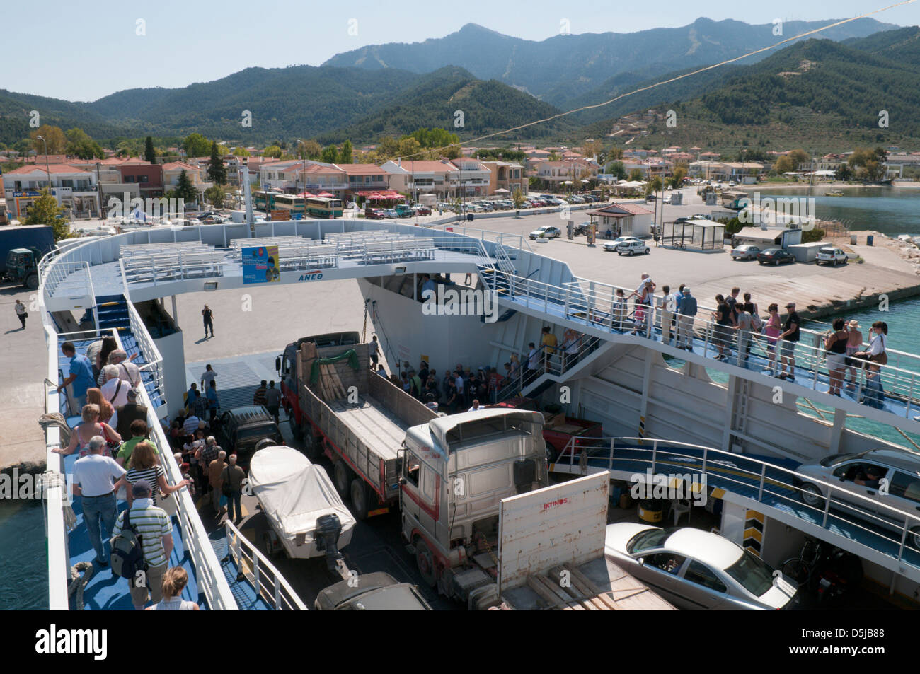September Ferry from Keramoti on the Greek mainland docking in harbour at Limenas (Thassos Town) - Stock Image