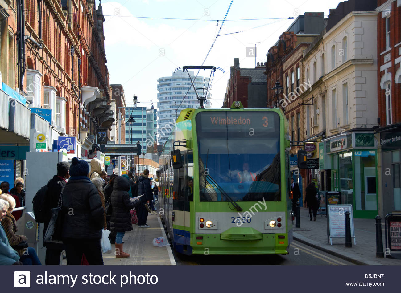 Wimbledon tram on George Street in Croydon. - Stock Image