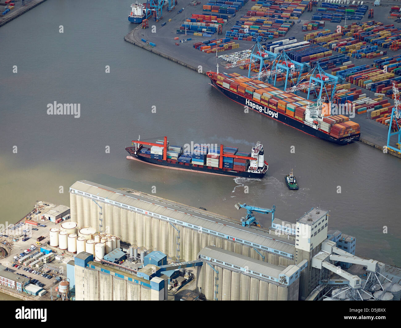 Container ship leaving at Liverpool Docks, Bootle, Merseyside, North West England UK - Stock Image