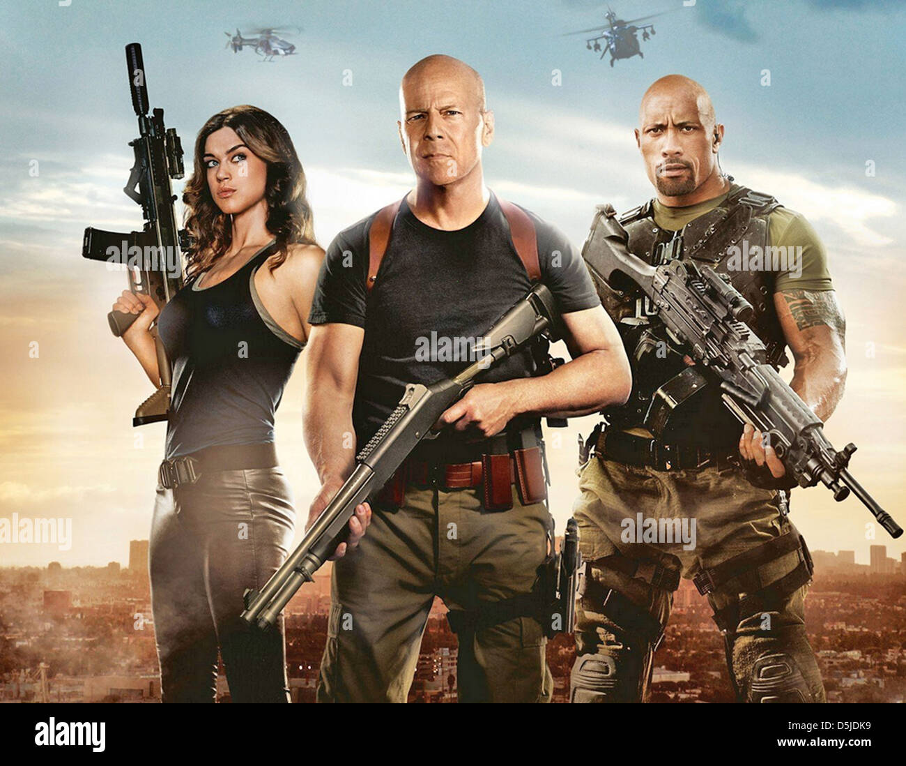 G.I. JOE: RETALIATION 2013 Paramount Pictures film with from left AdriannePalicki, Bruce Willis, The Rock - Stock Image