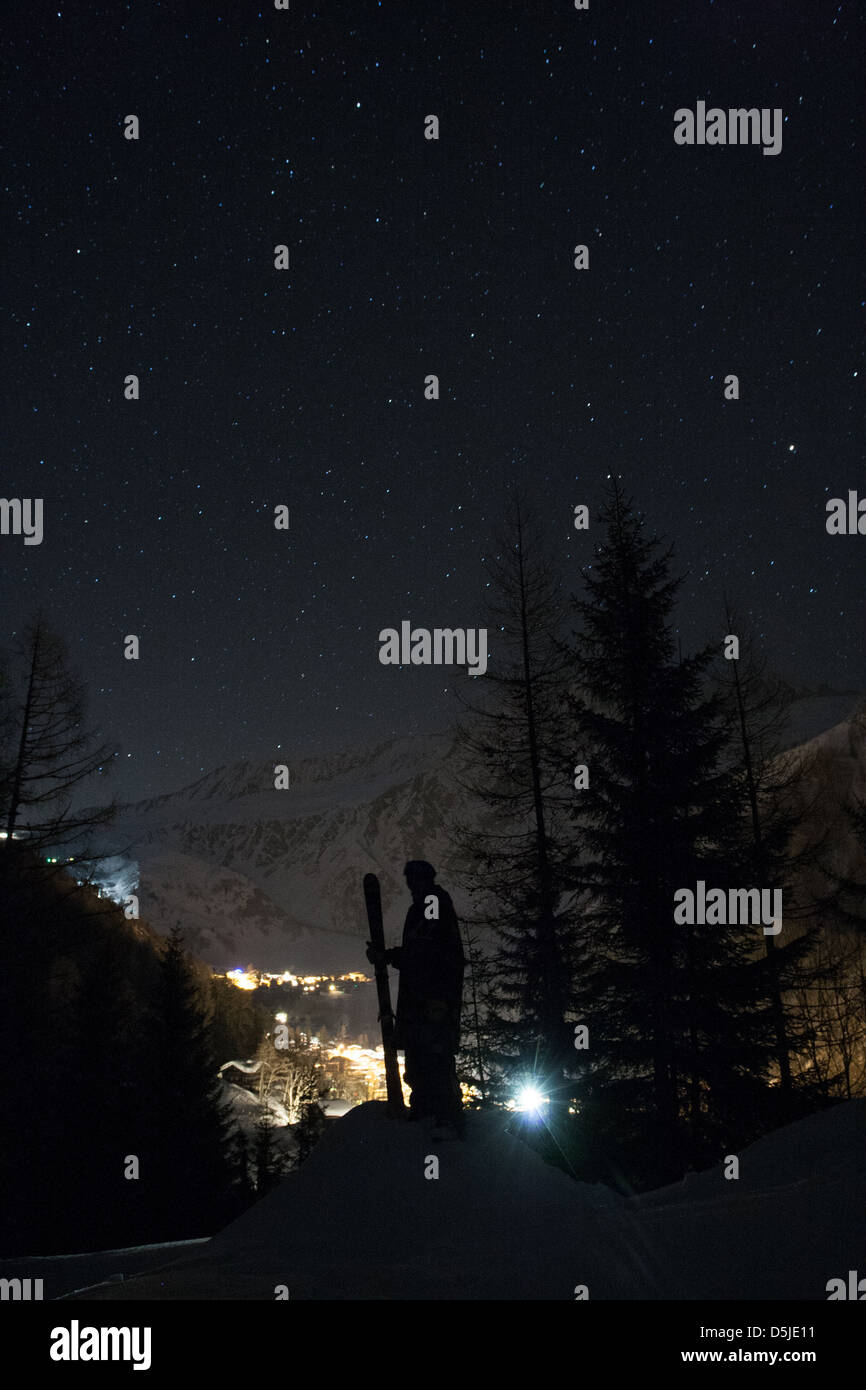 Skier exploring the mountain at night - Stock Image