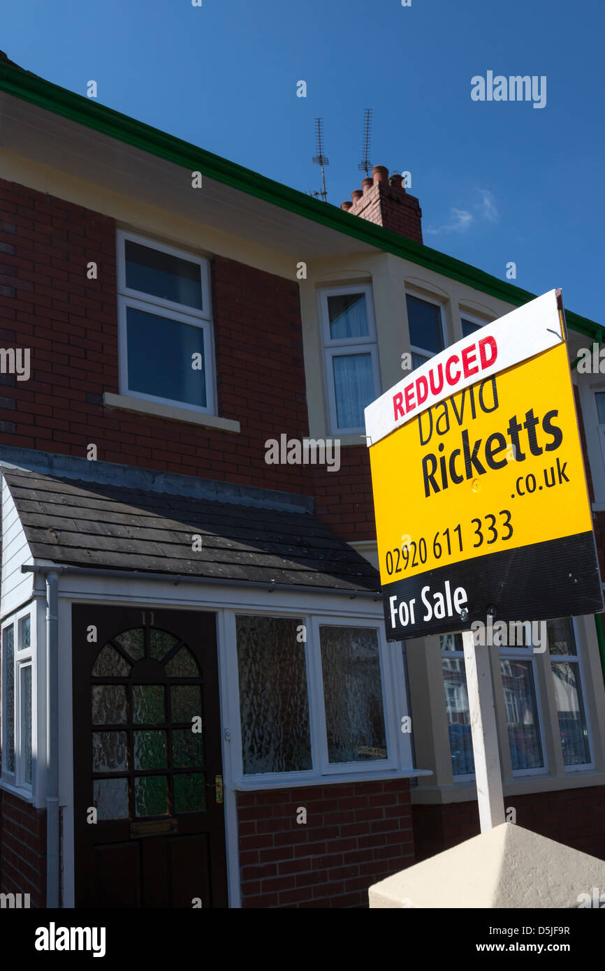 For sale reduced price on estate agent sign for house, Cardiff, Wales, UK - Stock Image