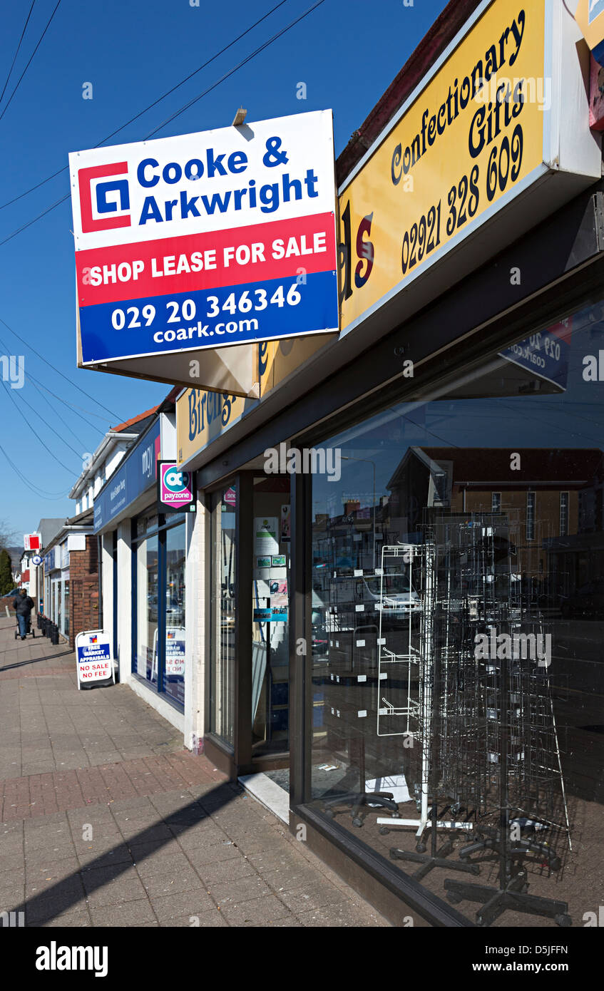 Lease for sale sign on closed shop on high street, suburban Cardiff, Wales, UK - Stock Image