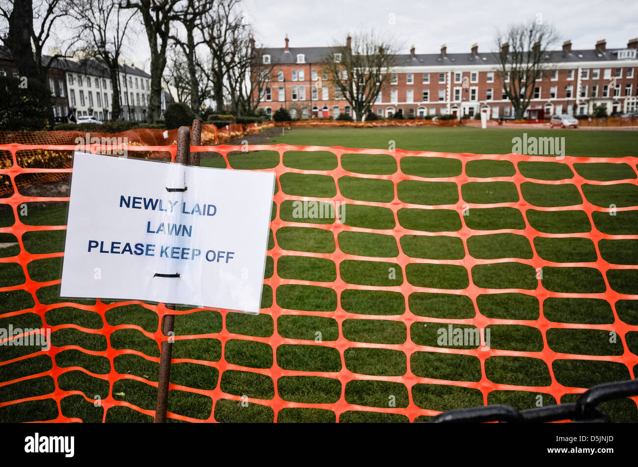 Sign on a newly laid lawn asking people to keep off. Stock Photo