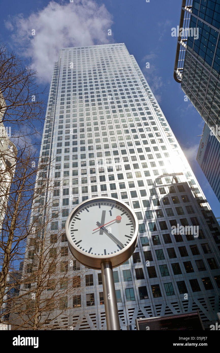 One of the Canary Wharf clocks close up in front of One Canada Square landmark skyscraper tower London Docklands - Stock Image