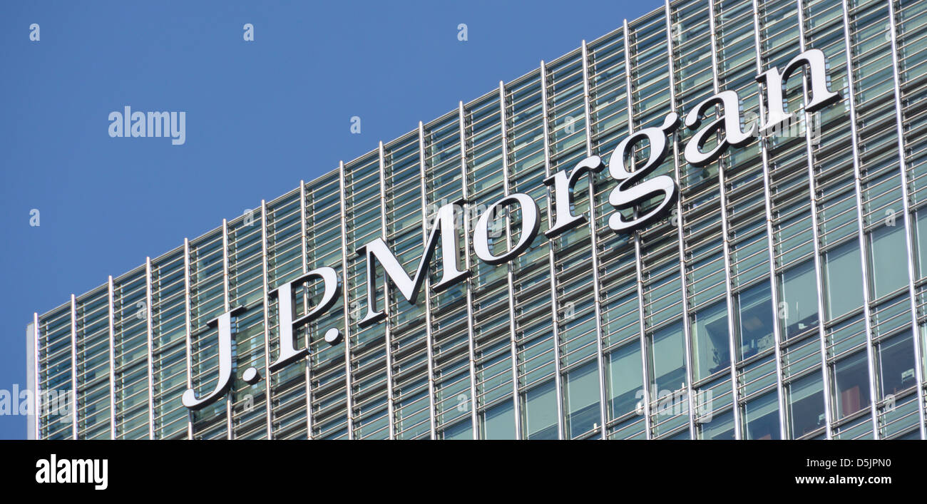 J P Morgan sign at top of London skyscraper office tower block Canary Wharf London Docklands Isle of Dogs Tower - Stock Image