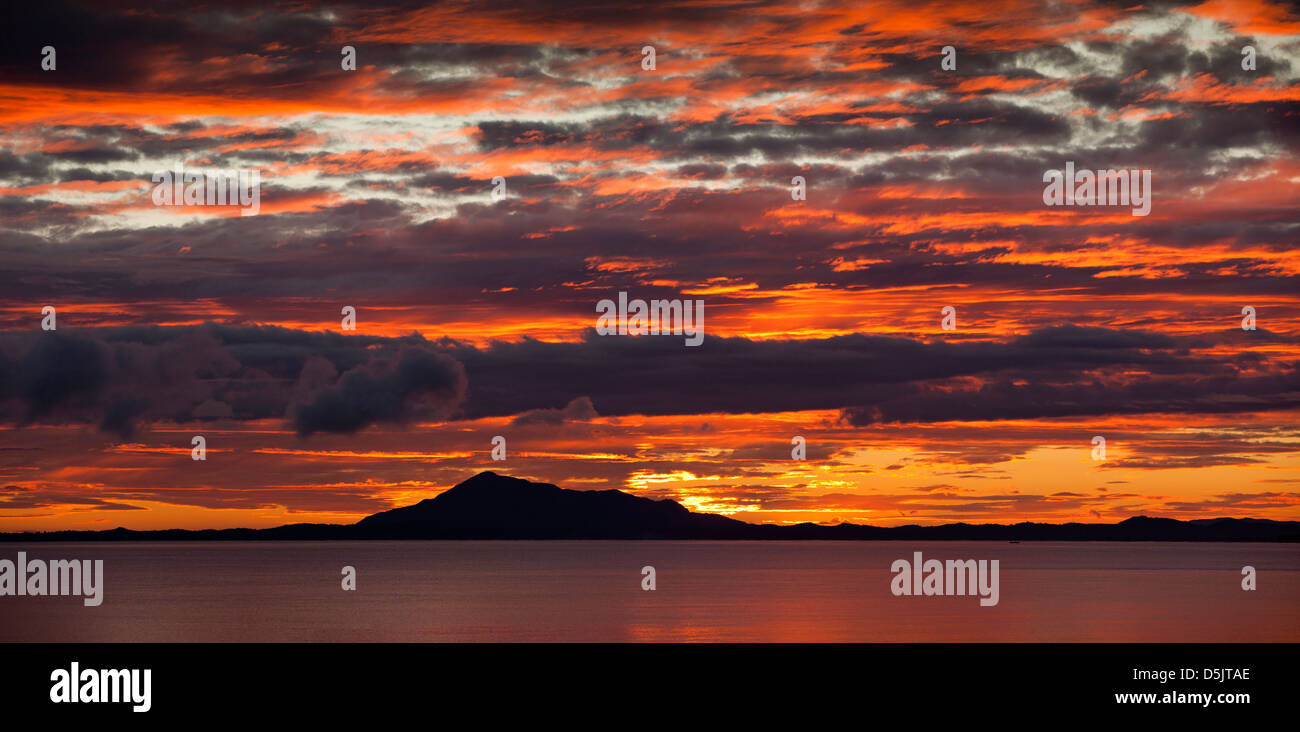 Madagascar, Ankify, sun rising over north Madagascan coast, panoramic - Stock Image