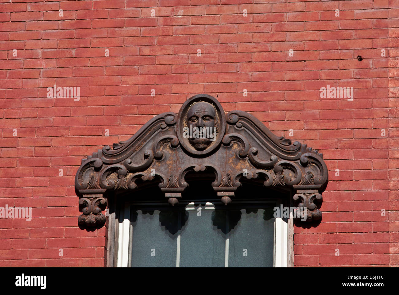 Rockland Maine, Main Street. A cast iron lintel on the face of a late 19th century commercial building. - Stock Image