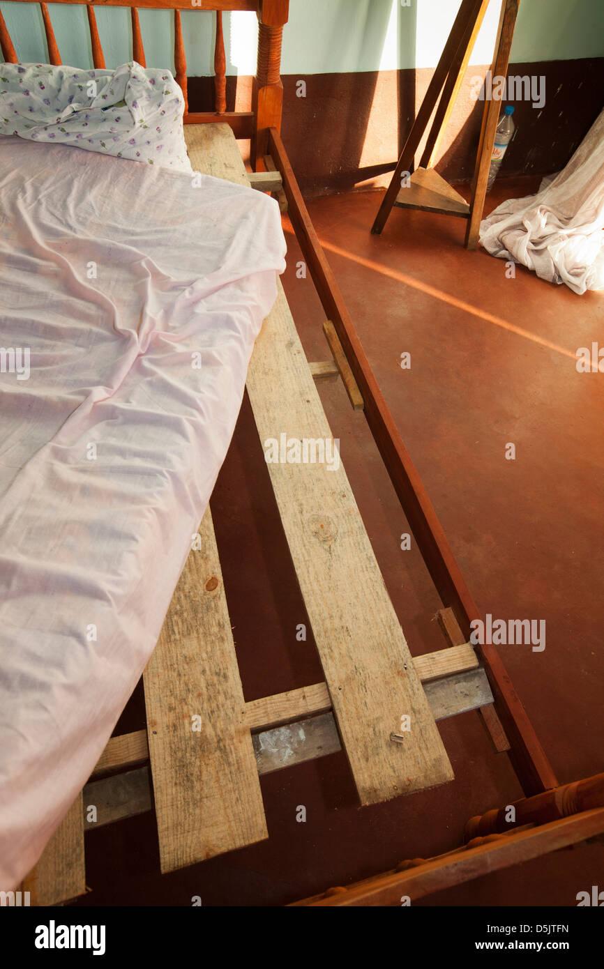 Madagascar, Ankify, badly made bed in Marina Hotel - Stock Image