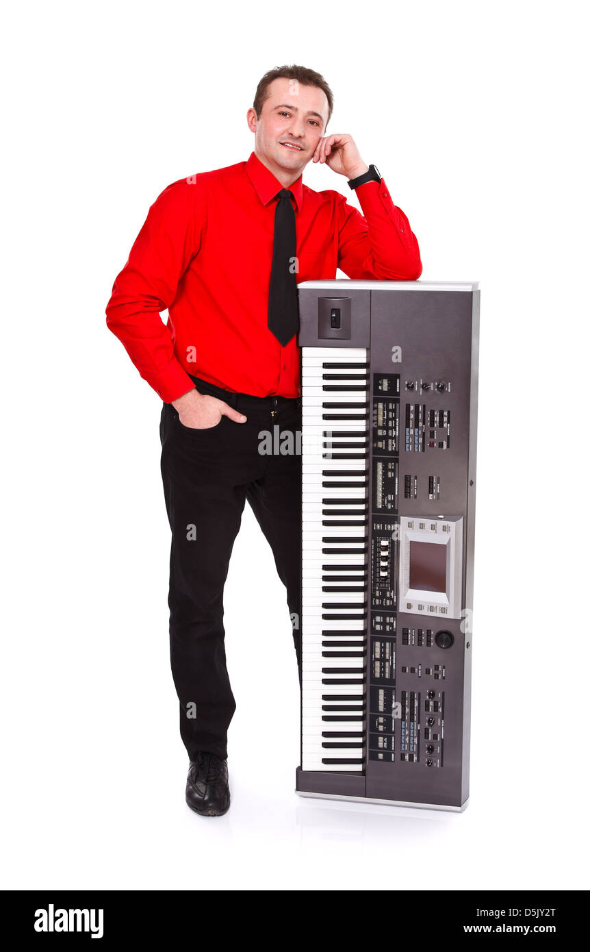 Impressive young man posing with synthesizer - isolated - Stock Image