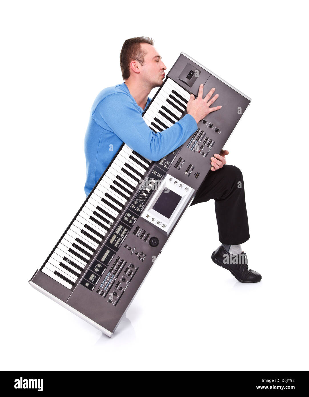 Enthusiastic musician kissing his favorite synthesizer - isolated - Stock Image