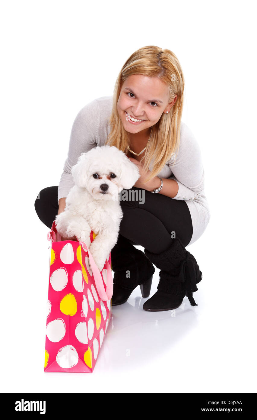 Happy girl received an adorable puppy as a gift - isolated - Stock Image
