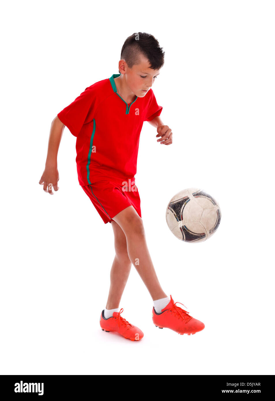 Young boy making soccer moves over white background - Stock Image