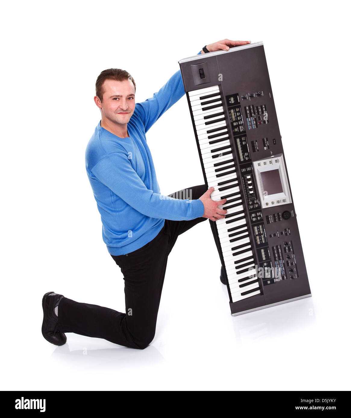 Handsome man posing with electric piano over white background - Stock Image
