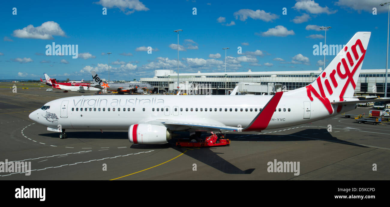 Virgin Australia Airbus 320 leaving it's stand at Sydney airport - Stock Image