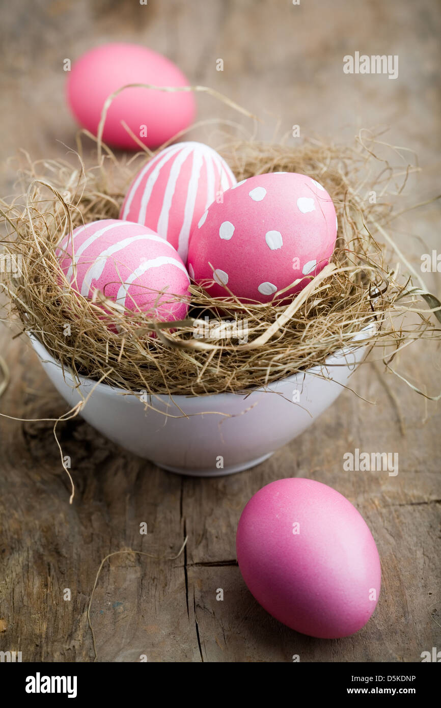 Painted easter egg in little bird nest - Stock Image