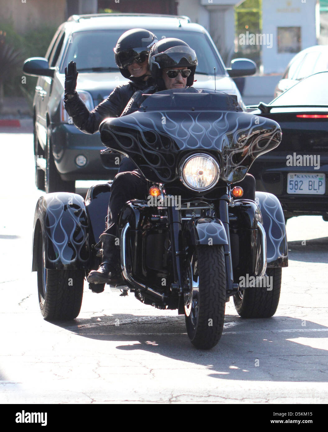 Aging french rocker Johnny Hallyday opts a 3 wheel Harley Davidson