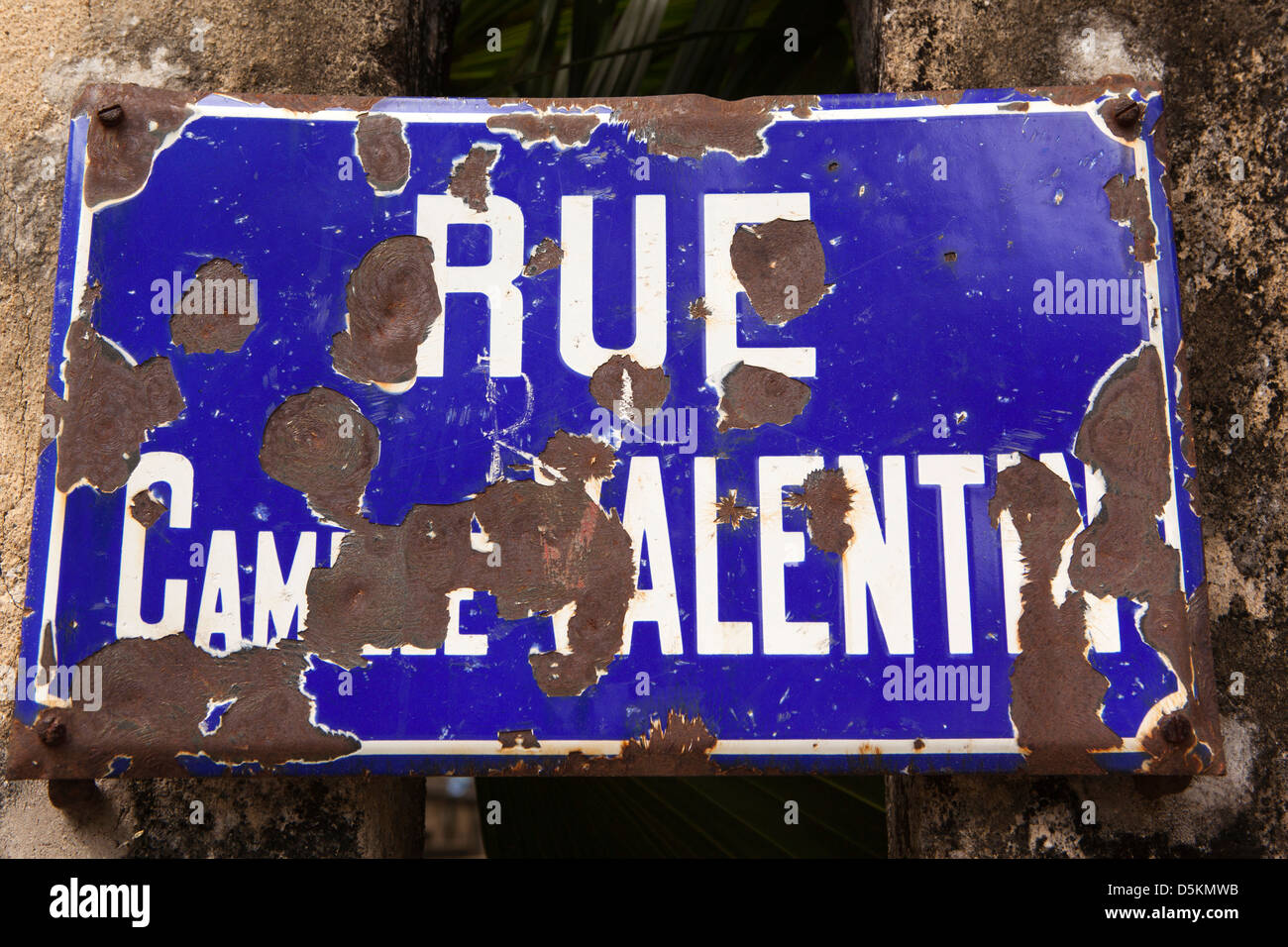 Madagascar, Nosy Be, Hell-Ville, Rue Camille Valentin chipped enamel French road name - Stock Image