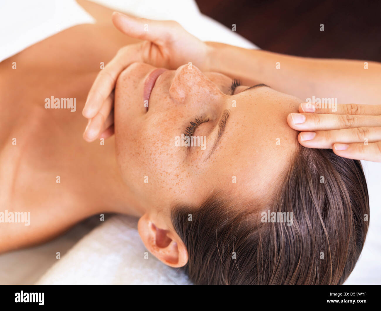 Woman relaxing in spa - Stock Image