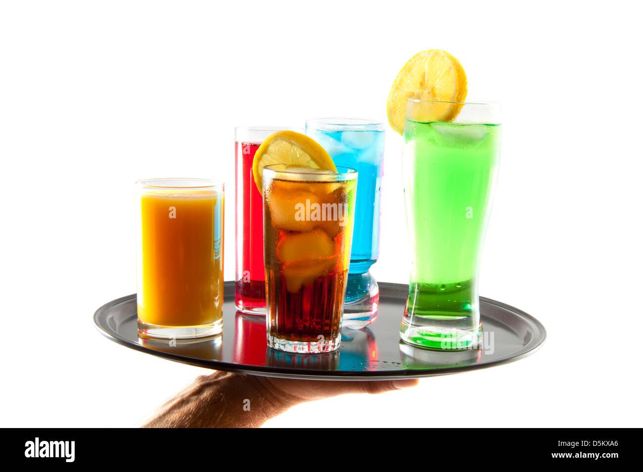 Different kind of drinks on a black tray over white - Stock Image