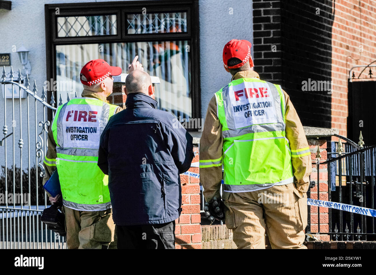 A fire investigation officer begins their examination of a fatal house fire. - Stock Image