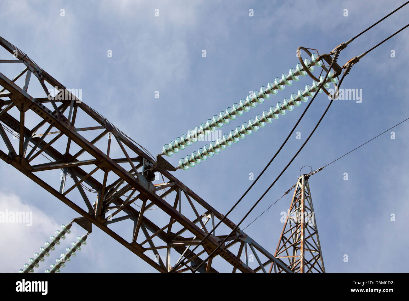 Steel lattice high voltage transmission tower - detail with cables and insulators - Stock Image