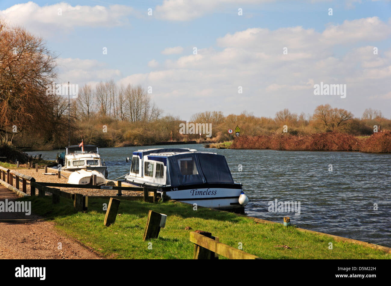 A view of two cruisers moored on the River Yare at Bramerton, Norfolk, England, United Kingdom. - Stock Image