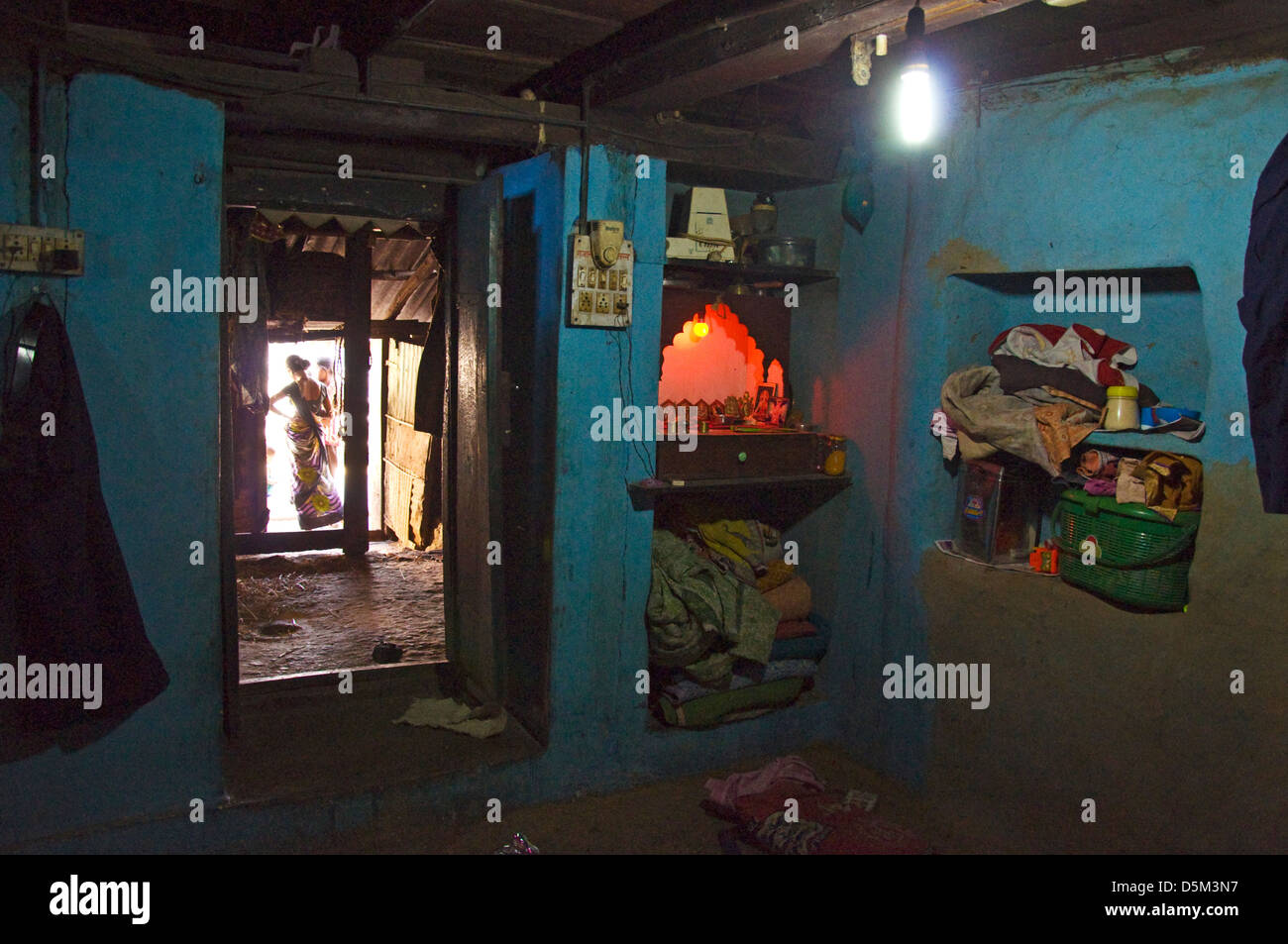 Rural Indian Home Interior With Hindu Shrine In Corner Of Room In  Khubalivali Village Mulshi Valley Paud Maharashtra India