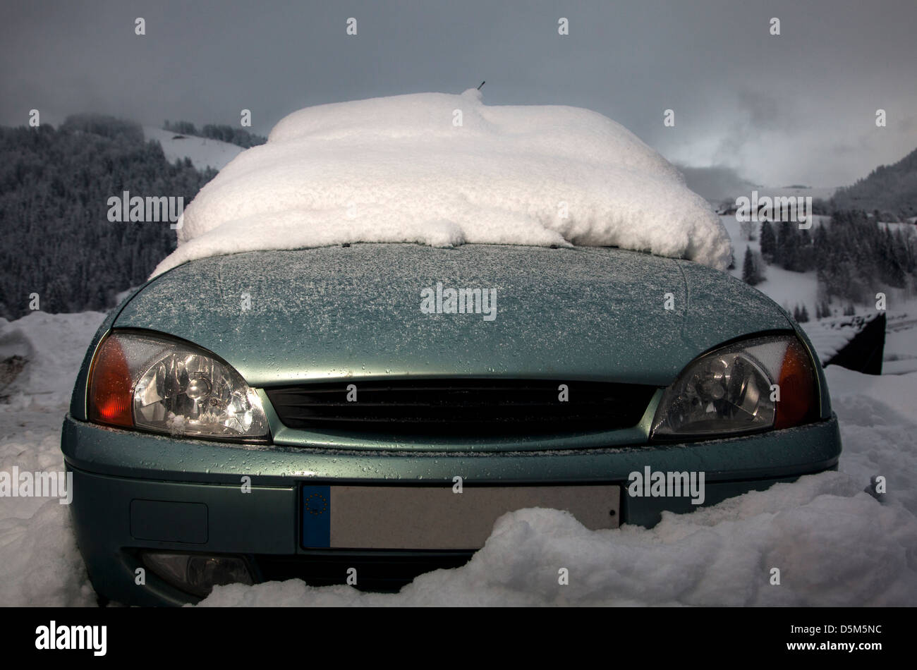 Car stuck in the snow with the windscreen covered, La Clusaz, France - Stock Image
