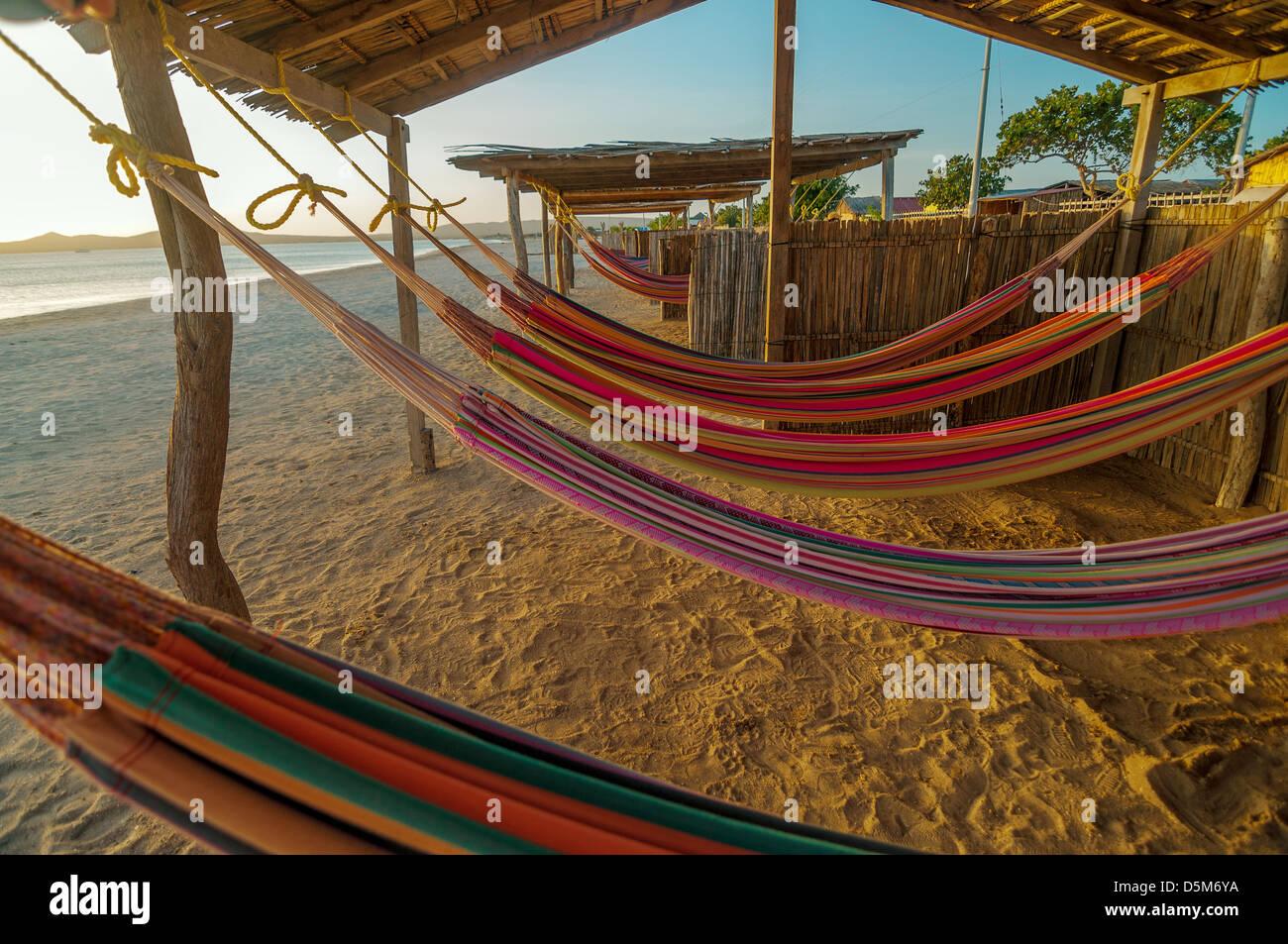 Colorful hammocks on a beautiful deserted bach in Cabo de La Vela in La Guajira, Colombia - Stock Image