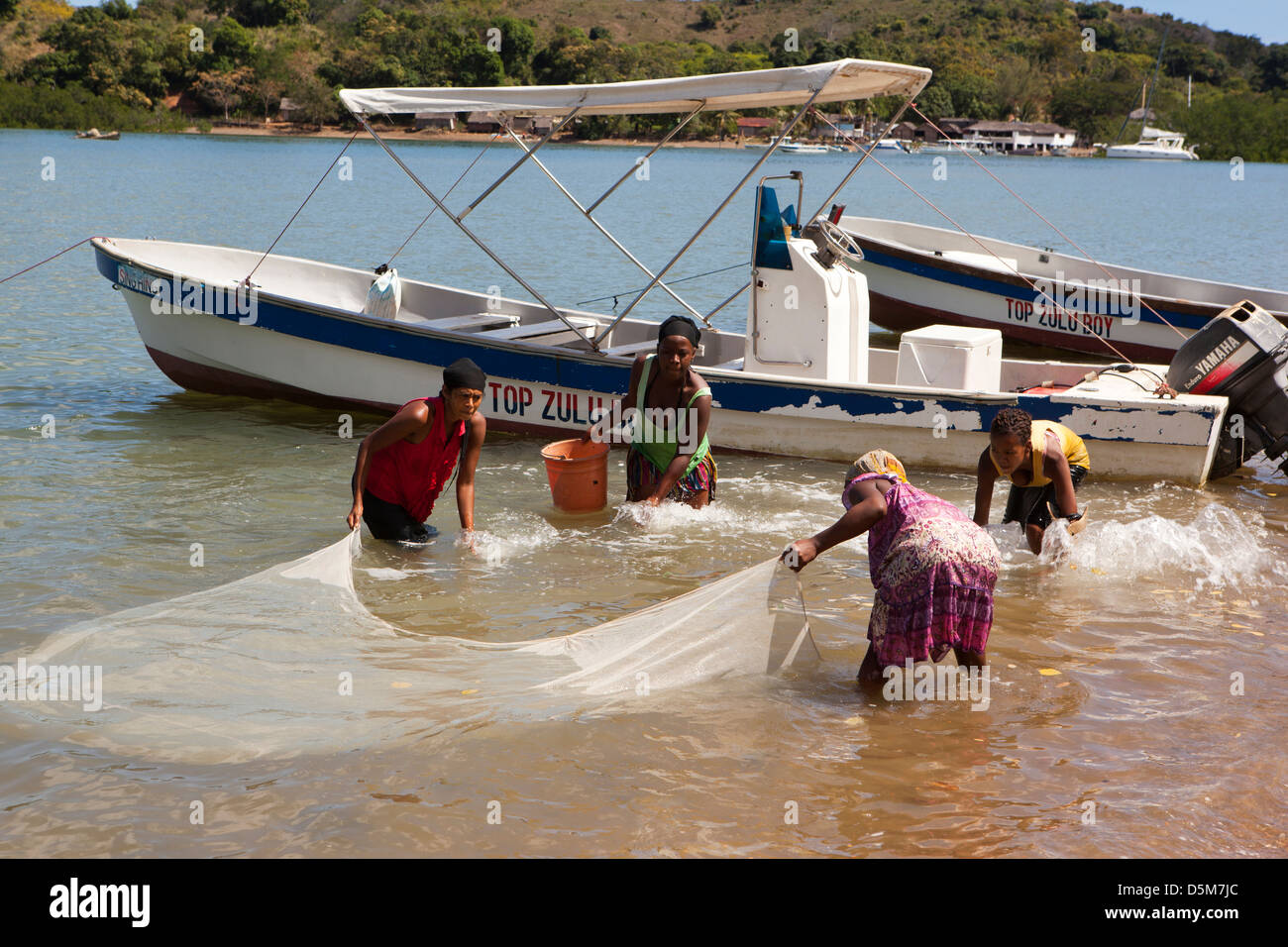 Madagascar, Nosy Be, Marodokana, women fishing in shallows at high tide Stock Photo