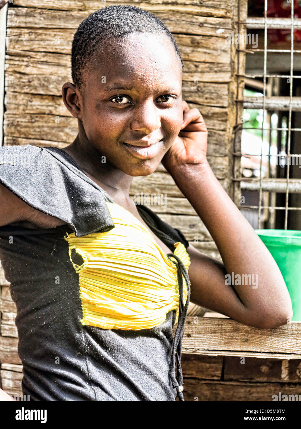 Young female Teenager posing for camera in Africa;East Africa;Tanzania;young and older women - Stock Image