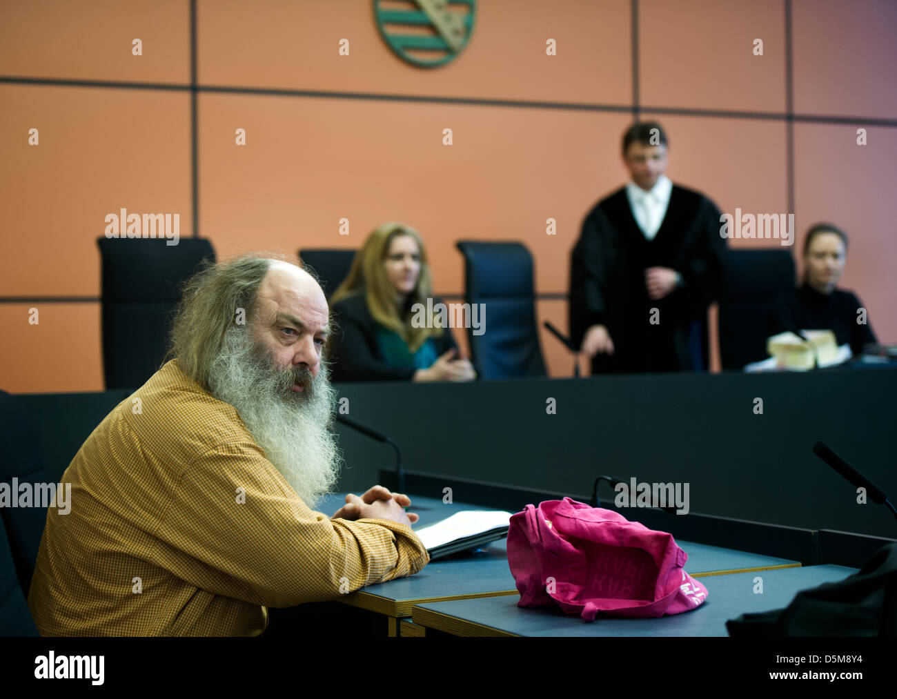 Dresden, Germany. 4th April 2013. Youth pastor from Jena Lothar Koenig takes his seat in the courtroom at the district Stock Photo