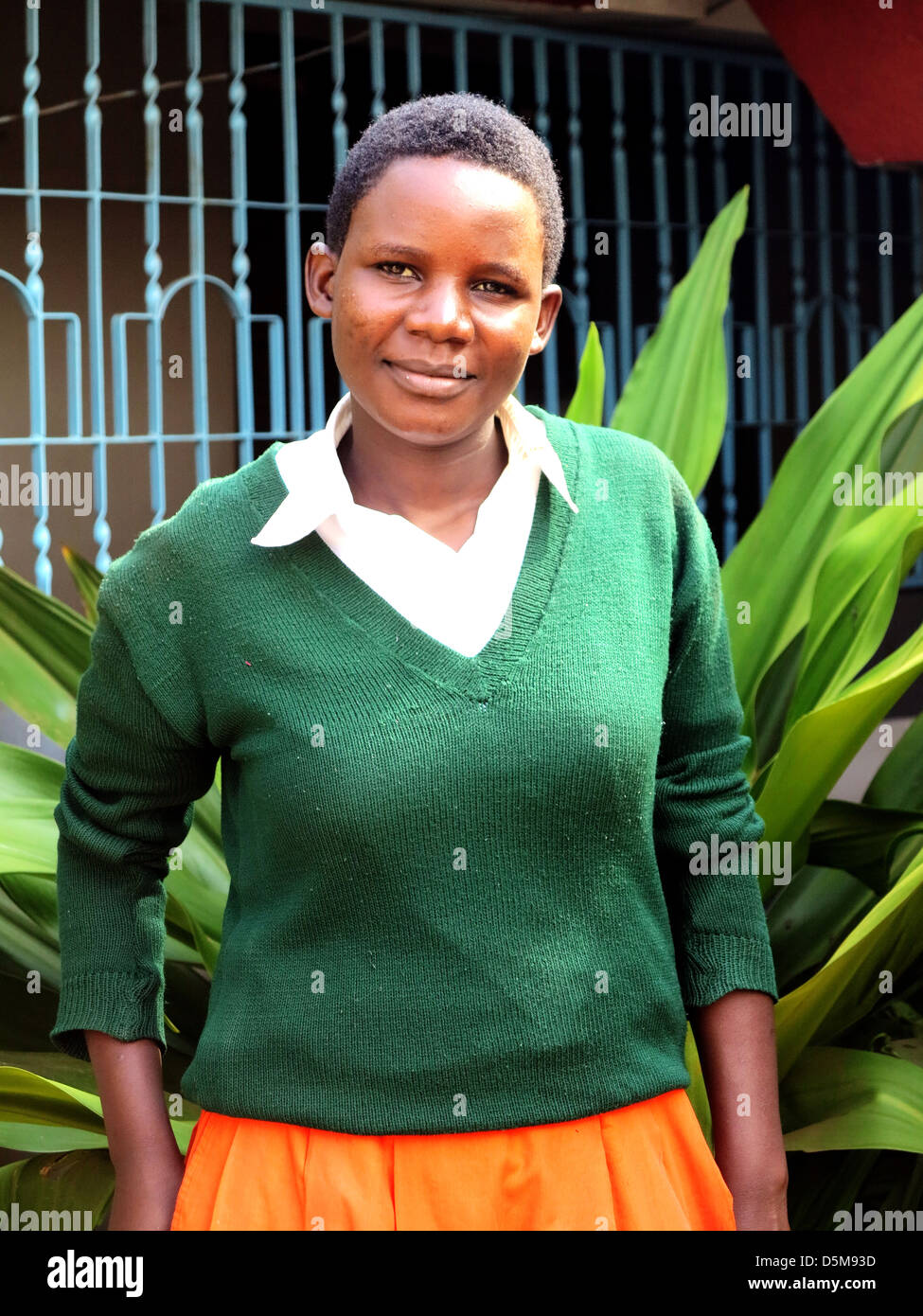 Teenager female in School uniform in Africa;East Africa;Tanzania;young and older women and Maasai women or woman - Stock Image