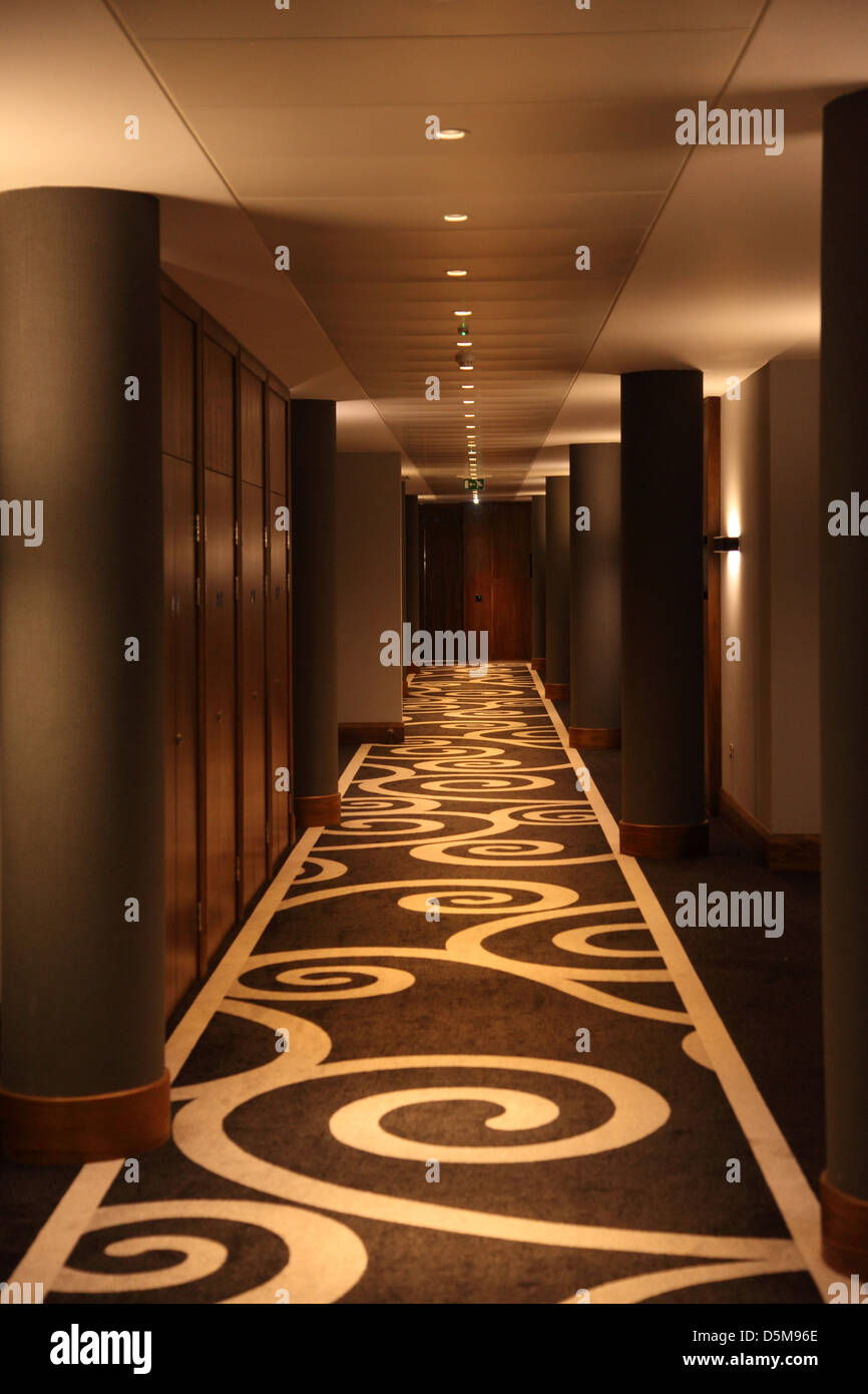 Hotel Corridor With A Modern Carpet And Lighting Design