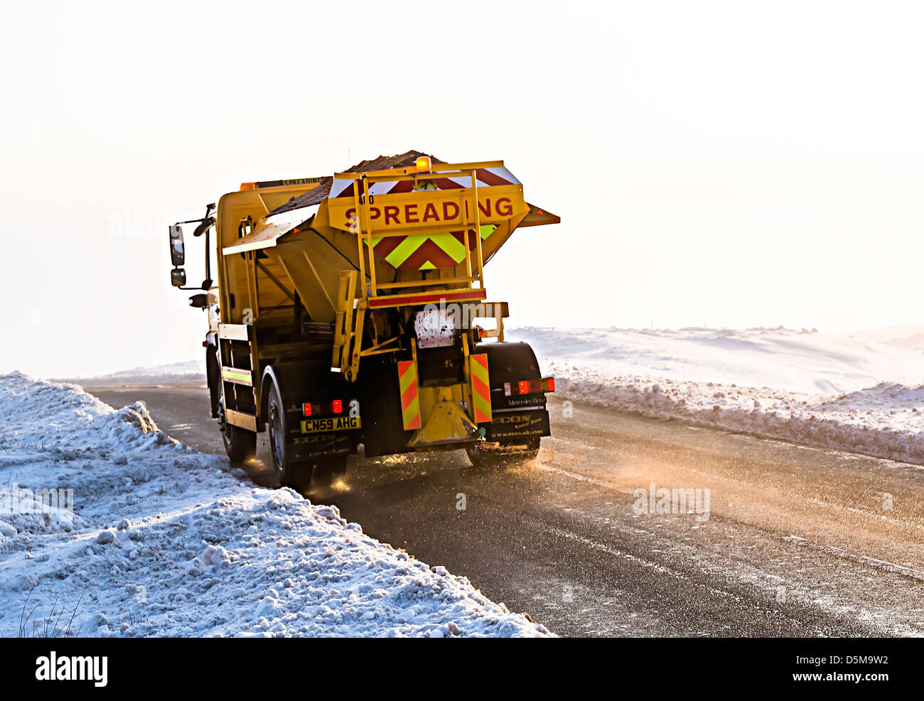 Grit spreading on moorland road to keep it open, Blorenge mountain, Wales, UK - Stock Image